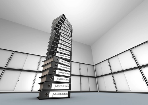 Pile of files with labelling _ Mahnungen  reminders  _ in front of file cabinets. : Stock Photo