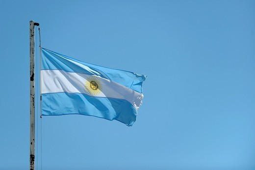 Stock Photo: 1848-420320 Flag of Argentina against a blue sky