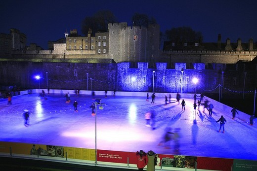 Artificial ice skating rink for Christmas skating in front of the Tower of London, UK : Stock Photo