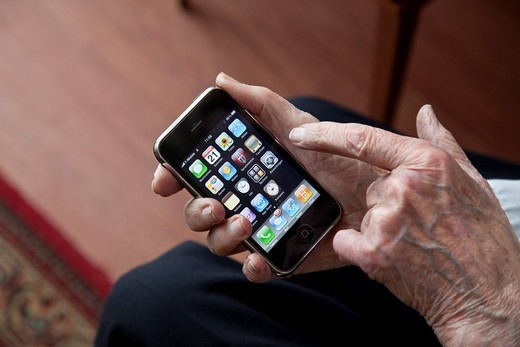 Stock Photo: 1848-421670 Elderly man using a smartphone, hands with iPhone