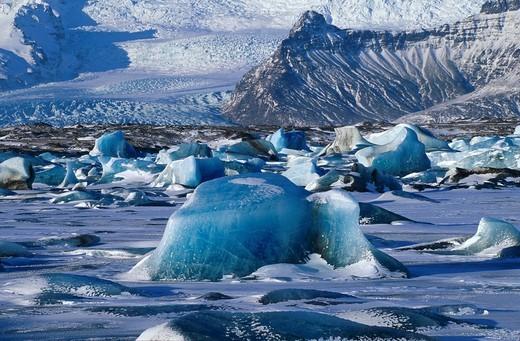 Joekulsarlon glacial lagoon, frozen in winter, iceberg, glacier tongue behind, mountain range, Iceland, Europe : Stock Photo