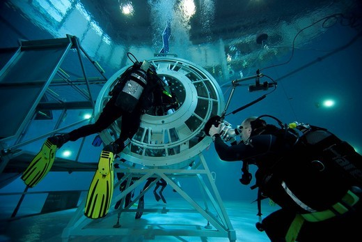 Backup divers and astronauts practicing with a space station module reproduction in a diving basin, European Space Agency, ESA, European Astronaut Center, EAC, Cologne, North Rhine_Westphalia, Germany, Europe : Stock Photo