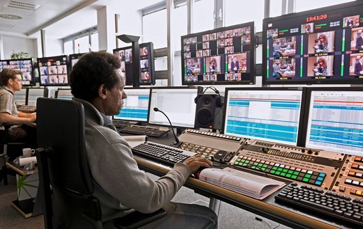 Technician at the Playout Center of ProSiebenSat.1 Media AG, where the network´s program is being broadcasted, the program is stored digitally on a central in_house server, broadcast center, Unterfoehring, Bavaria, Germany, Europe : Stock Photo