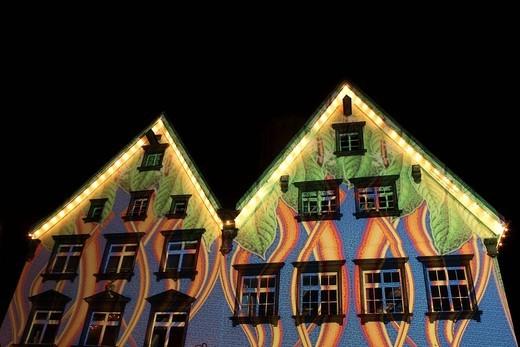 Illuminated building facades, light art, long exposure : Stock Photo