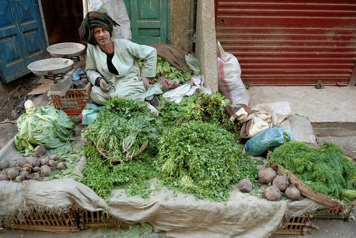 Stock Photo: 1848-425749 Egyptian man selling vegetables, historic town of Luxor, Egypt, Africa