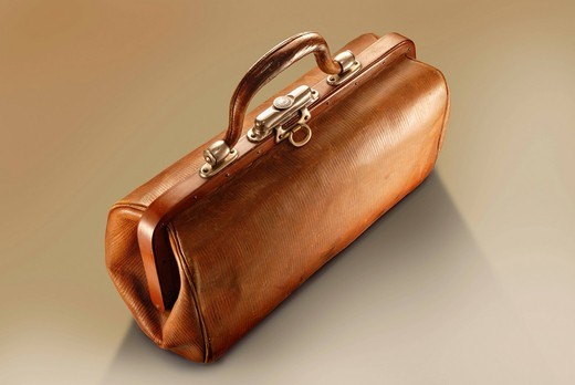 An old, brown doctor´s bag : Stock Photo