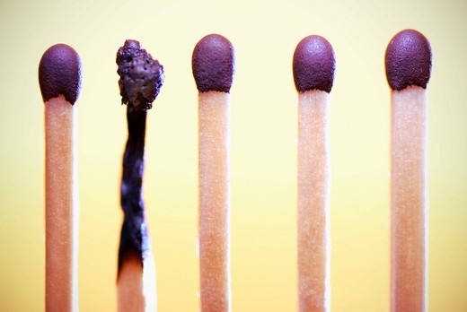 A burnt match between new matches, symbolic image burnout syndrome : Stock Photo