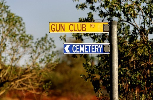 Stock Photo: 1848-428563 Interesting sign combination, Gun Club, cemetery, Mt Newman, Northwest Australia