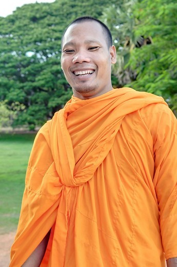Monk wearing an orange robe smiling, Angkor Wat complex, Siem Reap, Cambodia, Southeast Asia, Asia : Stock Photo