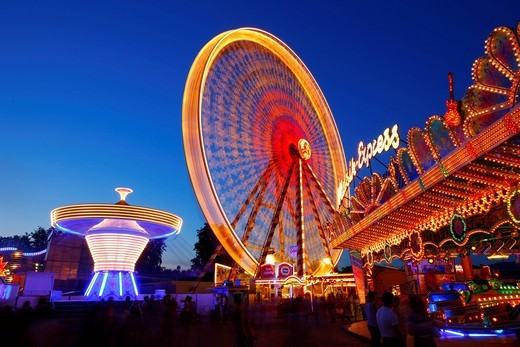 Stock Photo: 1848-429743 Ferris wheel, chairoplane, bumper cars, evening mood, folk festival, Muehldorf am Inn, Bavaria, Germany, Europe