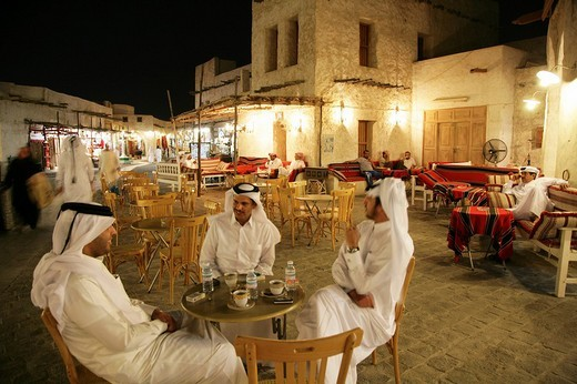 Men in a cafe in Souq al Waqif market, the oldest Souq or bazaar in the country, the old section has been recently renovated and the newer section reconstructed in a historical style, Doha, Qatar : Stock Photo