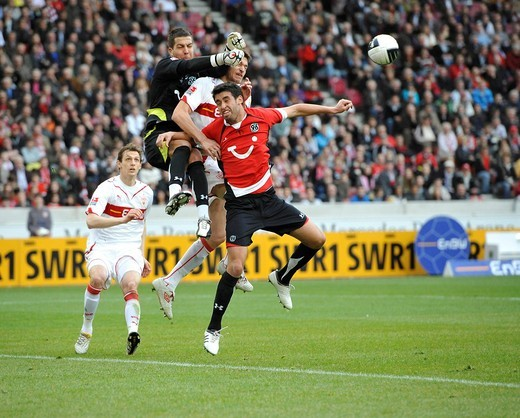 Stock Photo: 1848-430541 Goal area scene, goalkeeper Morten Jensen, Hannover 96 football club, in a duel against Matthieu Delpierre, VfB Stuttgart, on the far right Steve Sidwell, Hannover 96, left_Georg Niedermeier, VfB Stuttgart