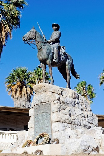 Landmark Reiterdenkmal or The Rider, equestrian monument after its relocation in 2010 in front of the Alte Feste fortress, unveiling in 1912 in memory of the colonial wars against the Herero and Hottentots in German South West Africa, historic center of t : Stock Photo