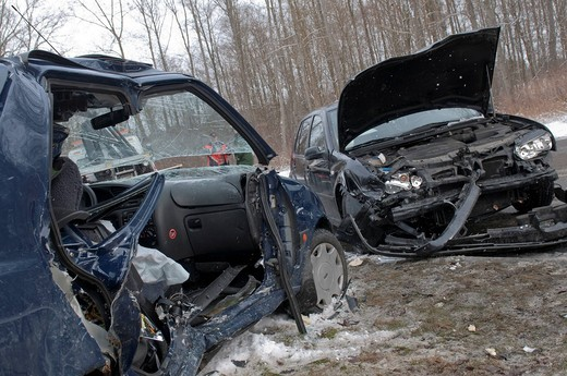 Head_on collision between a Volkswagen Golf and a Ford because of packed snow on the L 1182 road between Merklingen and Hausen, Baden_Wuerttemberg, Germany, Europe : Stock Photo