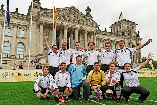 A cheering German blind football international team after the victory in the match against Turkey in front of the Reichstag building, Berlin, Germany, Europe : Stock Photo
