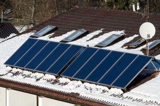 Roof with solar cells and patches of snow, Bayerisch Eisenstein, Bavarian Forest, Bavaria, Germany, Europe : Stock Photo