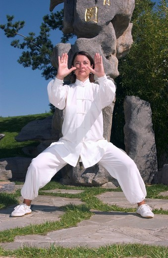 Stock Photo: 1848-435017 Woman, early 40s, doing Tai Chi in a Chinese garden in Berlin, Germany, Europe