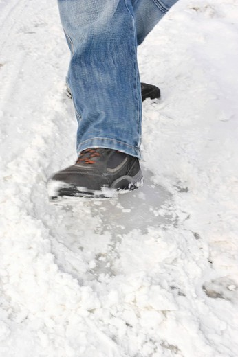 Young man slipping on an icy road : Stock Photo