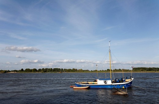 Stock Photo: 1848-437381 A small fishing boat on the river Rhine, in Kalkar_Grieth, Lower Rhine region, North Rhine_Westphalia, Germany, Europe