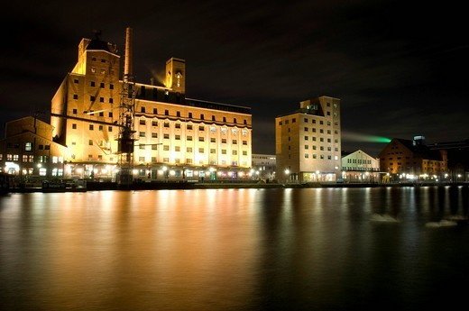 Wehrhahn_Muehle mill and Hafenforum office building in the Innenhafen Duisburg inner harbor at night, Ruhrgebiet area, North Rhine_Westphalia, Germany, Europe : Stock Photo