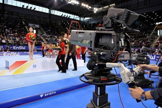 TV camera during a victory ceremony at EnBW Gymnastics World Cup 2009, Porsche_Arena Stuttgart, Baden_Wuerttemberg, Germany, Europe : Stock Photo