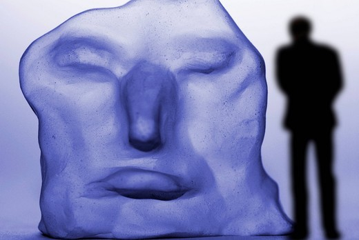 Lonely man in front of a distorted face, depression : Stock Photo