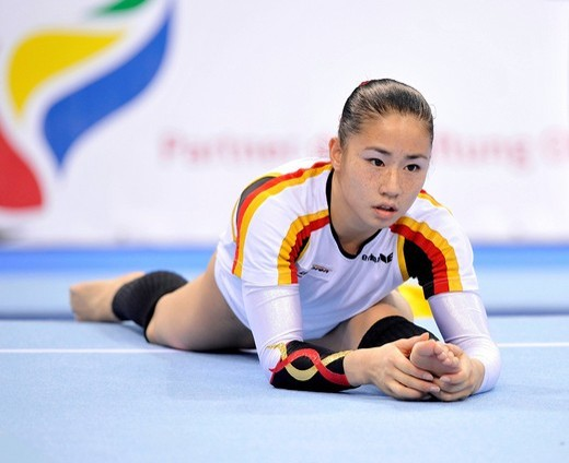 Stock Photo: 1848-437625 Kim Bui, Germany, warming_up, EnBW Gymnastics World Cup 2009, Porsche_Arena, Stuttgart, Baden_Wuerttemberg, Germany, Europe