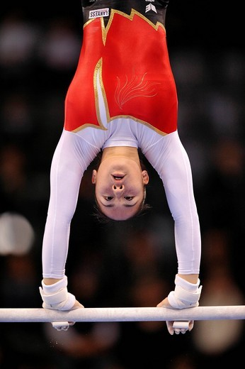 Kim Bui, Germany, performing on the uneven bars with hand protection for the high bar and uneven bars, EnBW Gymnastics World Cup 2009, Porsche_Arena, Stuttgart, Baden_Wuerttemberg, Germany, Europe : Stock Photo
