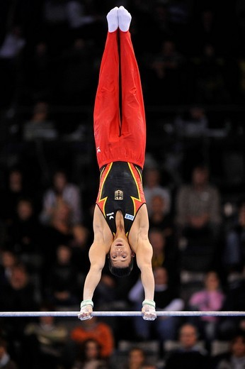Marcel Nguyen, GER, on the high bar, EnBW Gymnastics World Cup 2009, Porsche_Arena stadium, Stuttgart, Baden_Wuerttemberg, Germany, Europe : Stock Photo