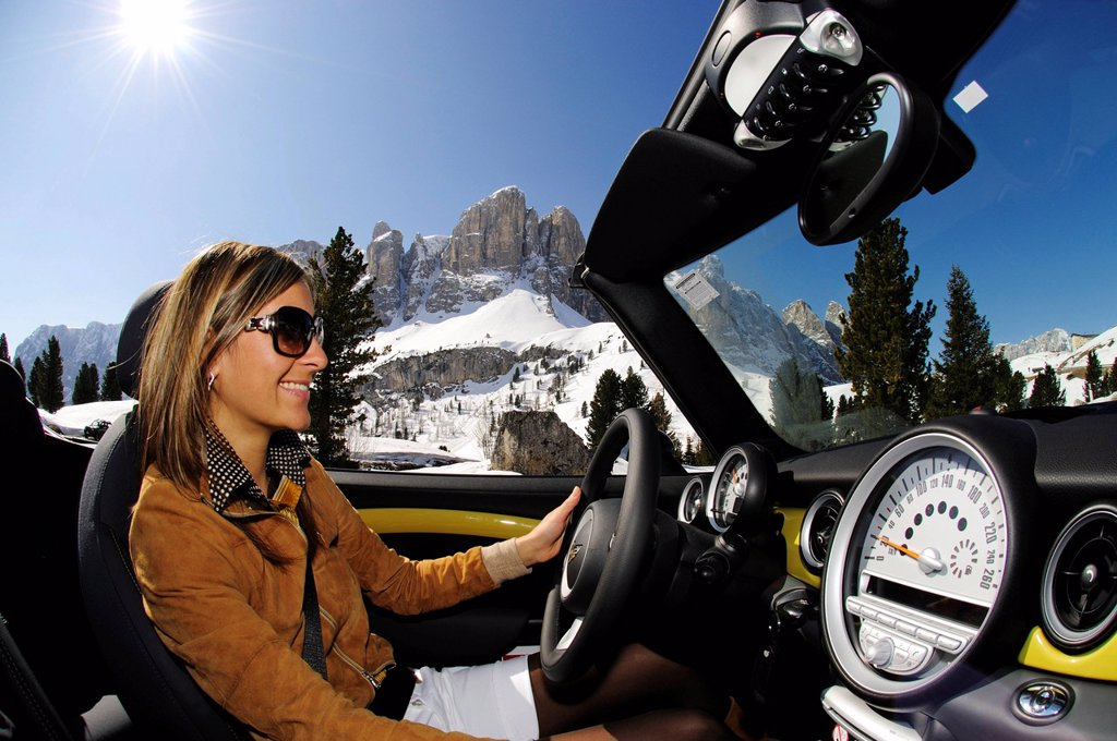 Stock Photo: 1848-438382 Woman driving Mini Cooper at the Gardena Pass, Alpine pass, South Tyrol, Italy, Europe