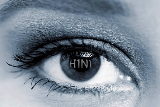Eye of a woman with the letters H1N1, swine flu : Stock Photo