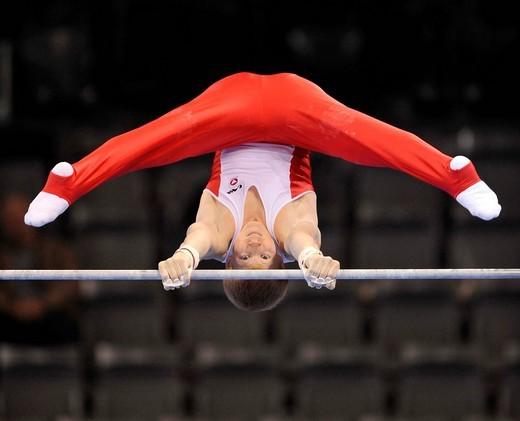 Lukas Kranzlmueller, Austria, on the high bar, EnBW Gymnastics World Cup 2009, Porsche_Arena, Stuttgart, Baden_Wuerttemberg, Germany, Europe : Stock Photo