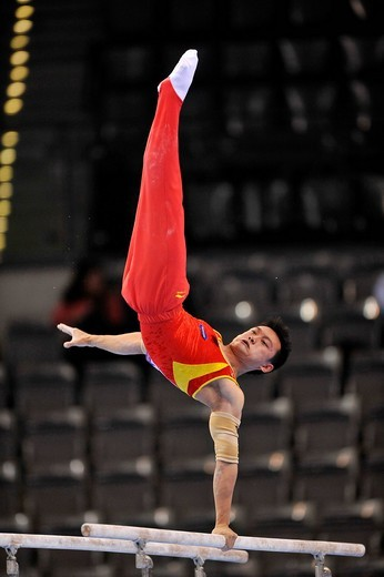 Guanyin Wang, China, on the parallel bars, EnBW Gymnastics World Cup 2009, Porsche_Arena, Stuttgart, Baden_Wuerttemberg, Germany, Europe : Stock Photo