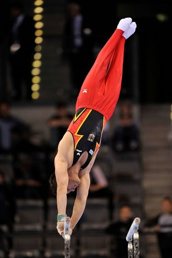 Stock Photo: 1848-439141 Sebastian Krimm, GER, on the parallel bars, EnBW Gymnastics World Cup 2009, Porsche_Arena stadium, Stuttgart, Baden_Wuerttemberg, Germany, Europe