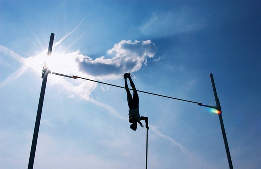 Silhouette of a pole vaulter : Stock Photo