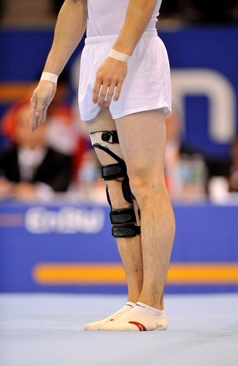 Michal Bolntnar, Czech Republic, performing floor exercises with a leg brace, EnBW Gymnastics World Cup 2009, Porsche_Arena, Stuttgart, Baden_Wuerttemberg, Germany, Europe : Stock Photo