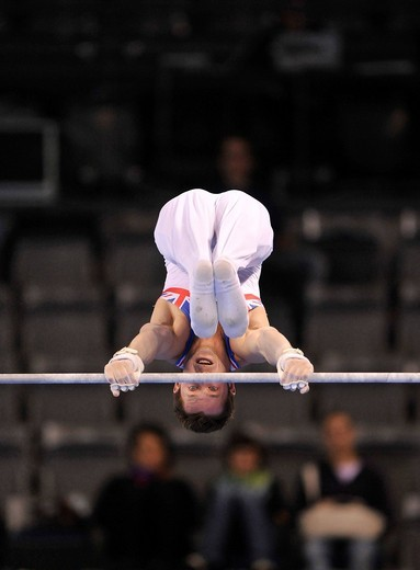 Evgeny or Yevgeny Gryshenko, Great Britain, on the high bar, EnBW Gymnastics World Cup 2009, Porsche_Arena, Stuttgart, Baden_Wuerttemberg, Germany, Europe : Stock Photo