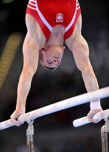 Roman Kulesza, Poland, on the parallel bars, EnBW Gymnastics World Cup 2009, Porsche_Arena, Stuttgart, Baden_Wuerttemberg, Germany, Europe : Stock Photo