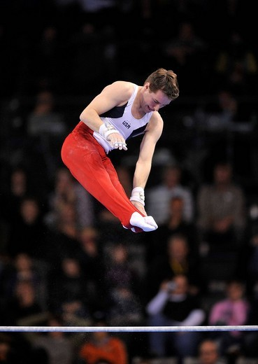 Stock Photo: 1848-440330 Joseph Hagerty, USA, on the high bar, EnBW Gymnastics World Cup 2009, Porsche_Arena, Stuttgart, Baden_Wuerttemberg, Germany, Europe