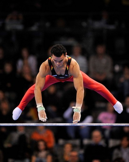 Stock Photo: 1848-440442 Matthias Fahrig, GER, with high bar and uneven bars hand_guards on the high bar, EnBW Gymnastics World Cup 2009, Porsche_Arena stadium, Stuttgart, Baden_Wuerttemberg, Germany, Europe