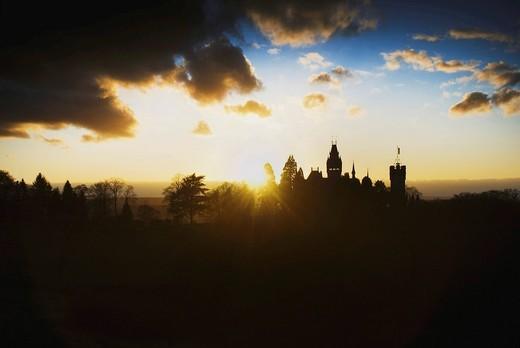 Schloss Drachenburg Castle with dramatic backlighting, silhouette, Koenigswinter, North Rhine_Westphalia, Germany, Europe : Stock Photo