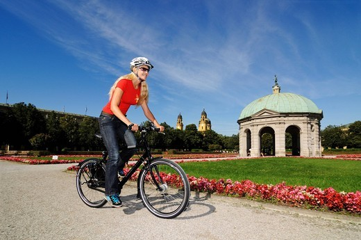 Stock Photo: 1848-440866 Young woman riding a bicycle, Hofgarten, Court Garden, Munich, Bavaria, Germany, Europe