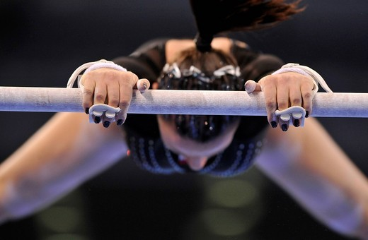 Detail, gymnast with hand protection for the high bar and uneven bars, Marta Pihan_Kulesza, Poland, EnBW Gymnastics World Cup 2009, Porsche_Arena Stuttgart, Baden_Wuerttemberg, Germany, Europe : Stock Photo