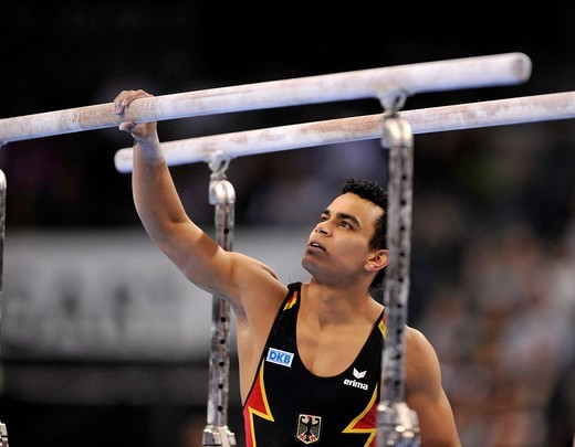 Matthias Fahrig, GER, preparing the parallel bars with magnesia, EnBW Gymnastics World Cup 2009, Porsche_Arena stadium, Stuttgart, Baden_Wuerttemberg, Germany, Europe : Stock Photo