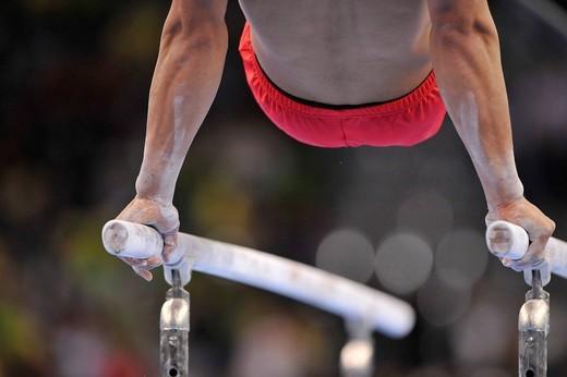 Detail, gymnast on parallel bars, EnBW Gymnastics World Cup 2009, Porsche_Arena Stuttgart, Baden_Wuerttemberg, Germany, Europe : Stock Photo
