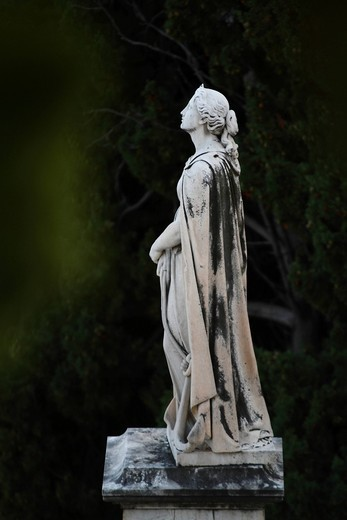 Statue of a woman with a cape on a tomb, Cimetière du Vieux Chateau cemetery, Menton, Alpes Maritimes, Région Provence_Alpes_Côte d´Azur, Southern France, Mediterranean Sea, France, Europe : Stock Photo