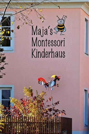 Stock Photo: 1848-442977 Maja´s Montessori Kinderhaus nursery, facade with modern scarecrow, Munich, Bavaria, Germany, Europe