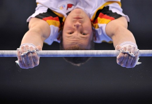 Detail, Fabian Hambuechen, GER, on the high bar, EnBW Gymnastics World Cup 2009, Porsche_Arena stadium, Stuttgart, Baden_Wuerttemberg, Germany, Europe : Stock Photo