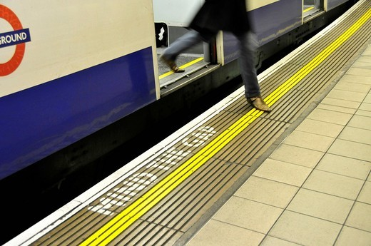 Passenger leaving the underground in the Monument Station, Mind the Gap, London, England, United Kingdom, Europe : Stock Photo