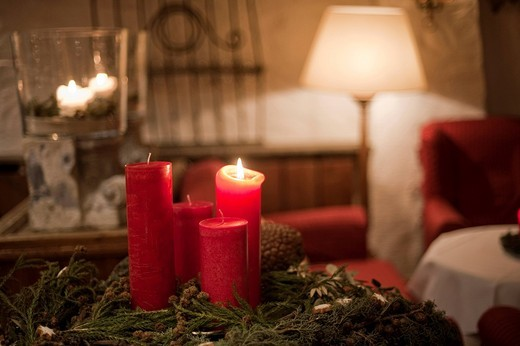 Burning candle on an advent wreath : Stock Photo